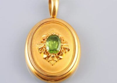 A Victorian Gold Locket Pendant, on a gold oval link chain. £2,000.