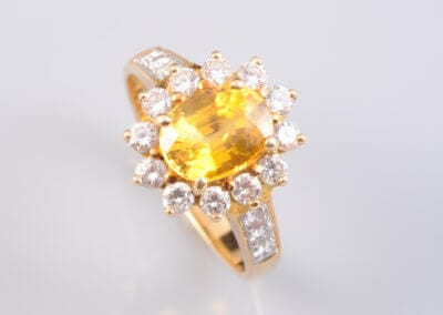A Yellow Sapphire and Diamond Cluster ring, set in 18 Carat Gold.  £3,500.