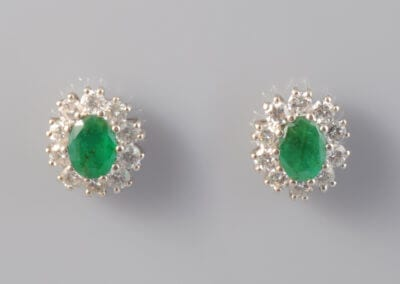 A Pair of Emerald and Diamond Earrings. £800.