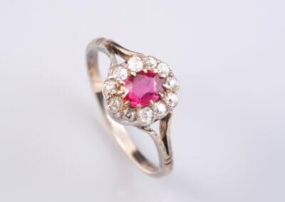 A Ruby and Diamond Cluster Ring, set in 18 carat white gold.  £480.