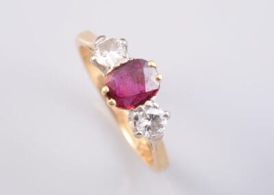 A Ruby and Diamond Ring., set in 18 carat gold.  £800.