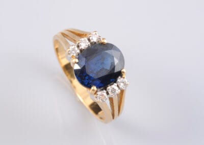 A Sapphire, Diamond Dress Ring, marked '750'.