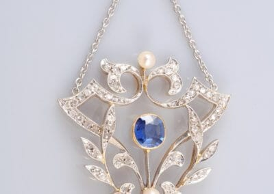 A Sapphire, Diamond and Pearl Pendant, circa 1900, Mounted in Gold and Platinum. £2,000.