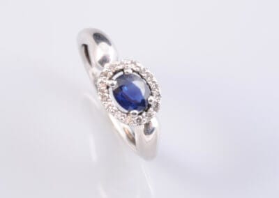 A Sapphire and Diamond Cluster Ring. £350.