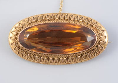A Victorian Citrine and Gold Brooch, circa 1870. £800.