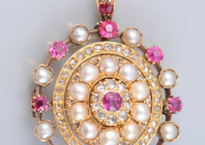 A Victorian Gold Ruby and Pearl Pendant, circa 1880. £POA.