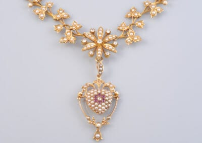 A Victorian, Gold and Pearl Necklace with Detachable Pearl and Ruby Heart Pendant, Circa 1890. £1,200.