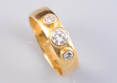 An 18 Carat Gold and Three Stone Diamond Ring