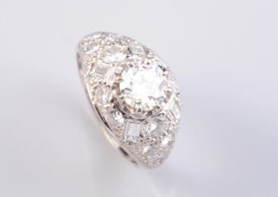 An Art Deco Style Diamond Dress Ring, set in 18 carat white gold. £3,700.