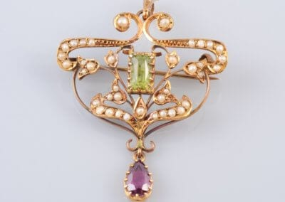 An Art Nouveau Amethyst, Peridot and Seed Pearl Brooch Pendant, circa 1890. £450.