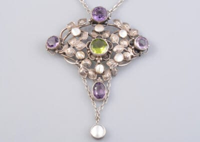 An Arts and Crafts Silver, Amethyst and Peridot Necklace with Pearl Highlights, circa 1900.  £1,200.