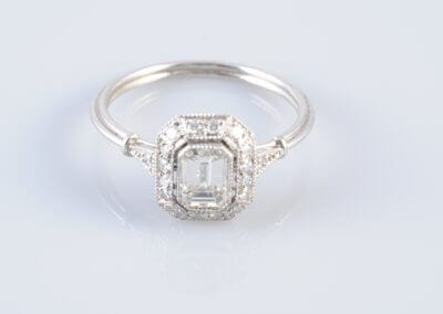 An Emerald-Cut Diamond Ring, platinum mount. £2,700.