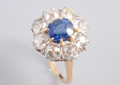 A Sapphire and Diamond Cluster Ring, marked '18ct'. £6,000.
