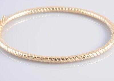 A 9 carat Gold Twist Bangle.  £1,300.