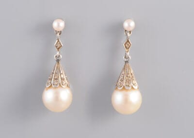 A pair of Cultured Pearl and Diamond earrings. £725.