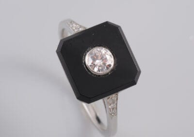 An Onyx and Diamond Ring. £1,800.