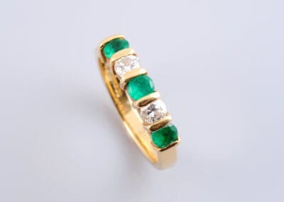 Emerald and Diamond Half Hoop Eternity Ring, set in 18 ct gold. £800.
