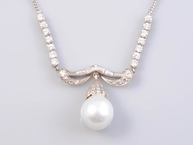 A Diamond and Pearl Necklace. £2,500
