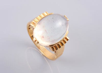 A Swiss 18ct gold and Moonstone ring c 1950. £750.
