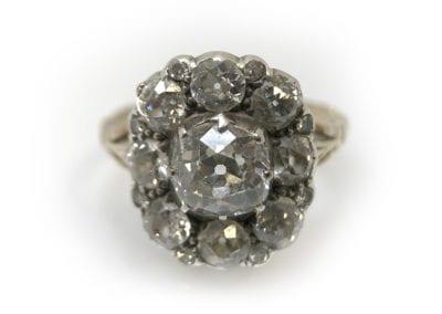 A Georgian Diamond Cluster Ring, circa 1820. Central cushion-cut diamond approx 1.3 carats £10,750