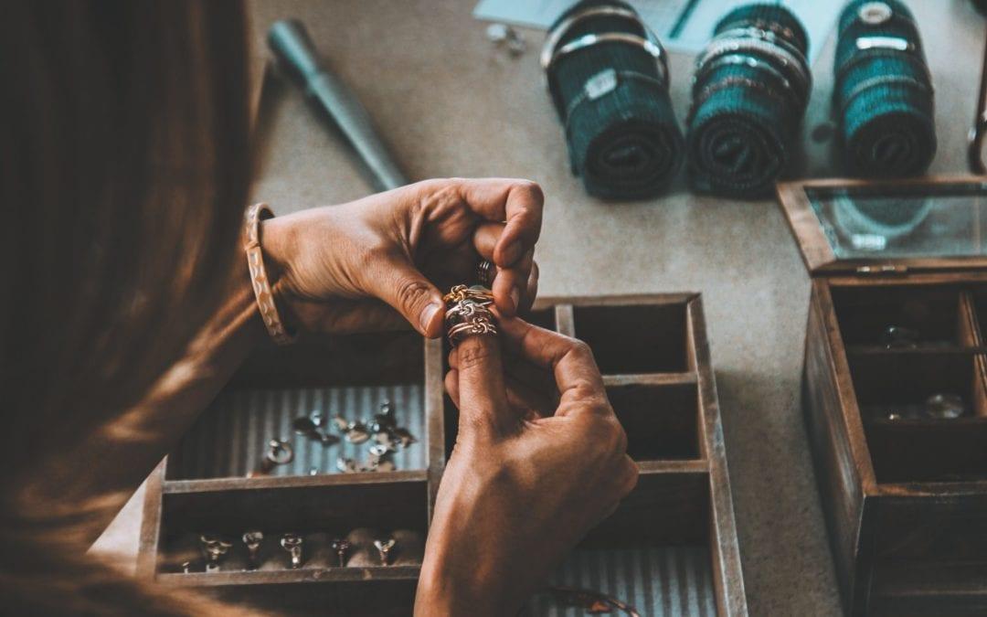 Jeweller-Selecting-Rings