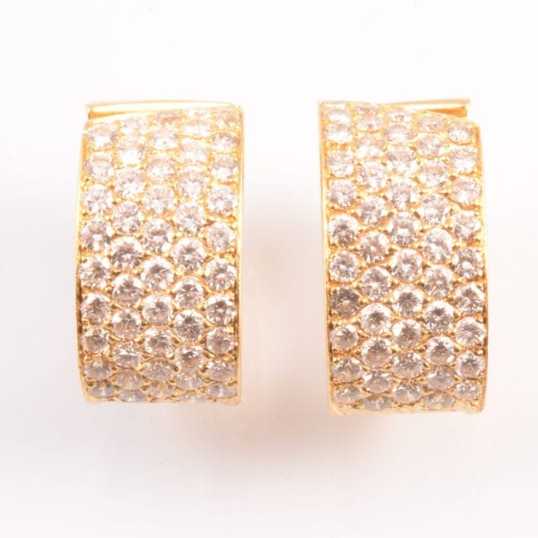 SRMA900127 A A Pair of Diamond and 18ct Gold ear Clips